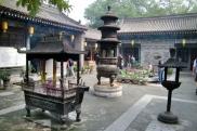 Chinesischer Tempel, die Räucherstäbchen nehmen die Luft zum atmen.