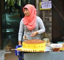 Orientalische Nachspeise aus Reisbrei, Rosinen und Rosenwasser